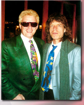 Handsome, confident, smiling Heino standing next to some guy.