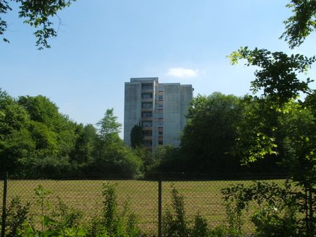Apartment High-Rise Above Field