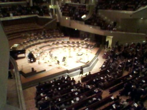 a blurry cellphone picture of the berlin philharmonic