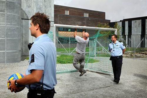 Norwegian prison guards frolicking and gamboling with inmates
