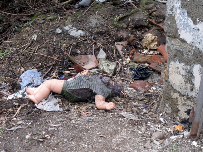 015 - Prizren - Mutilated Doll in Courtyard of Abandoned Serbian House